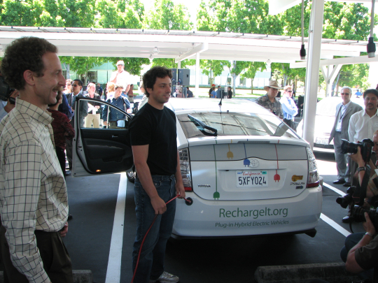 Google's Sergey Brin plugs in the car to start the V2G demonstration