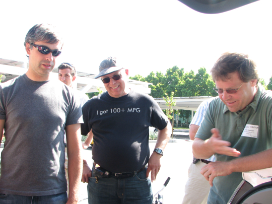 EDrive's Greg Hanssen explains his prototype to Google's Larry Page and Calcars' Ron Gremban.